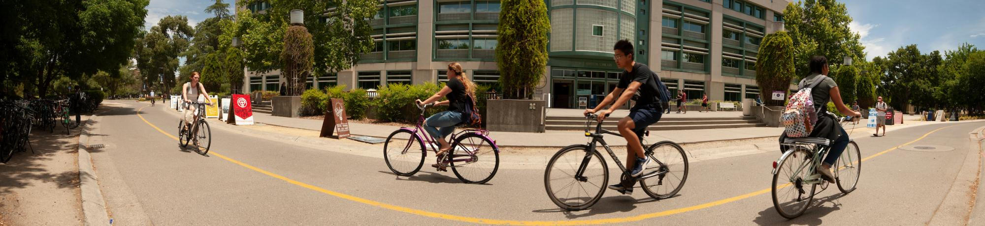 Image of bicyclists in front of Shields Library.